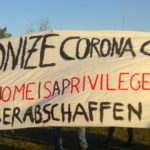 """Activists hold a banner saying """"Decolonize Corona Crisis, Staying home is a privilege, Alle Lager abschaffen"""""""